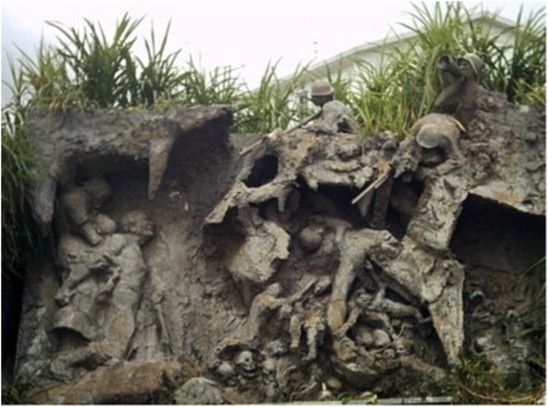 Okinawan sculptor Kinjo Minoru's relief depicting the Battle of Okinawa, during which many Okinawans were killed or forced to commit suicide after seeking refuge in the island's caves.